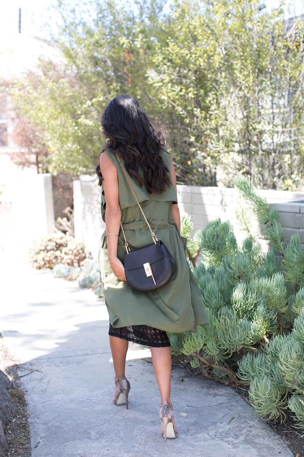 how to wear long vest, olive duster, see through skirt outfit, pursuit of shoes