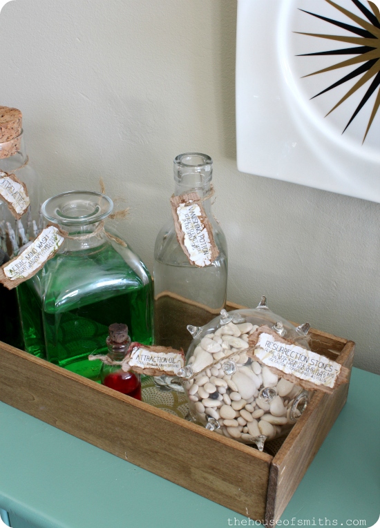 DIY potion bottles with labels in wooden box - thehouseofsmiths.com #halloweendecor