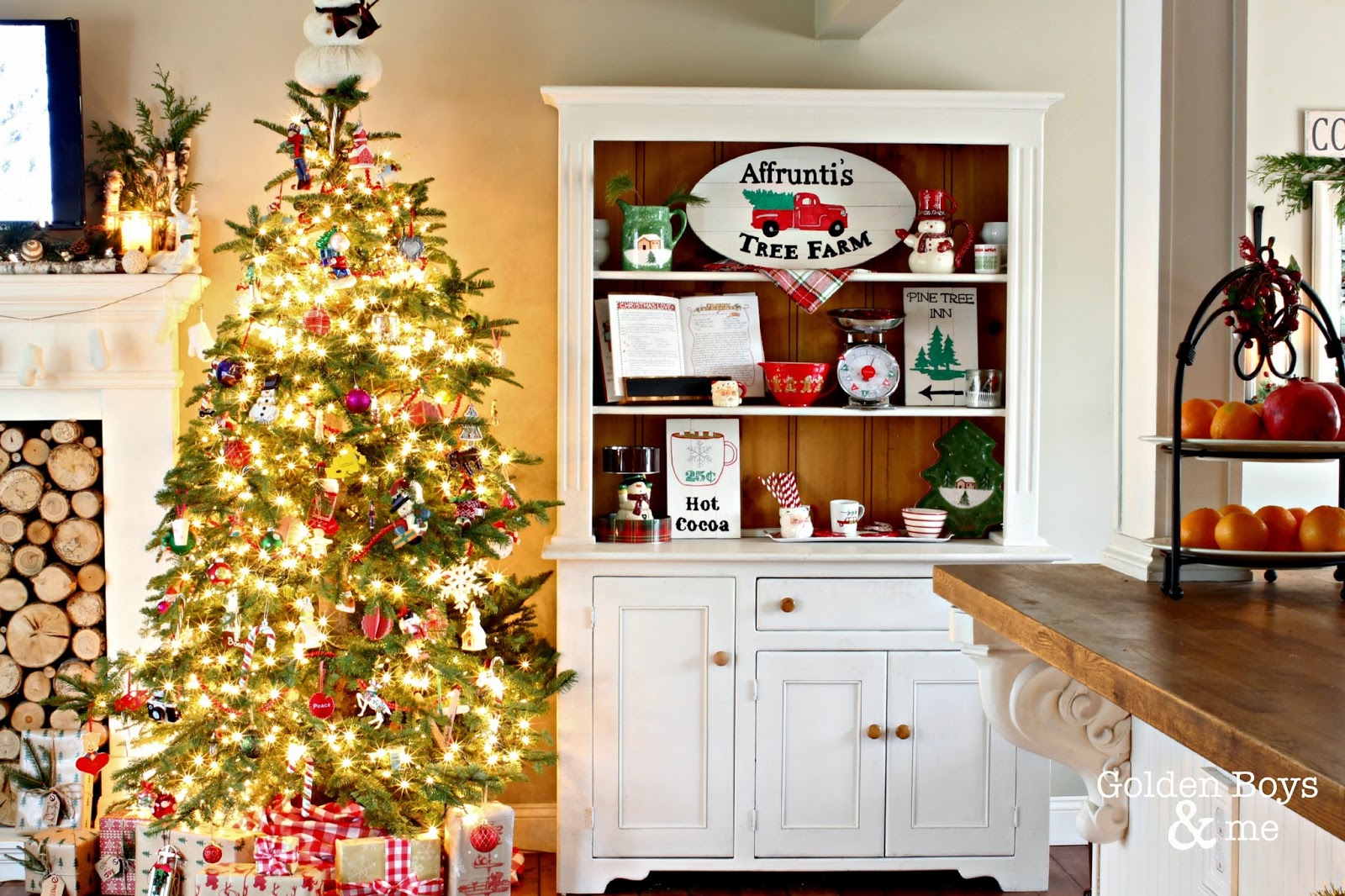 Christmas themed hutch with DIY painted signs-www.goldenboysandme.com