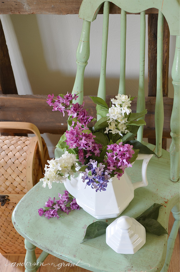 Ironstone teapot with lilacs on shabby green chair