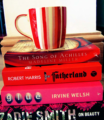 red and pink books, spines, pretty book covers, mug, cup of tea, stack of books, reading list, decoration, pile of books, colours