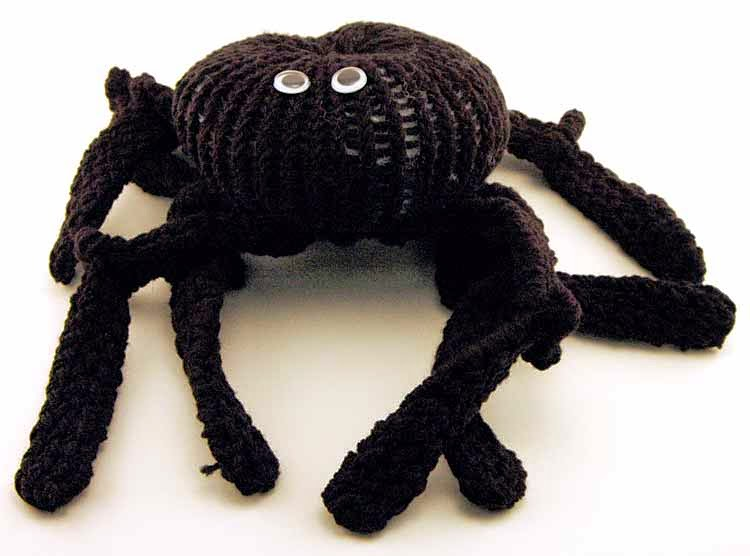 http://kniftyknitterweekly.blogspot.com/2014/04/black-spider-for-yellow-loom.html