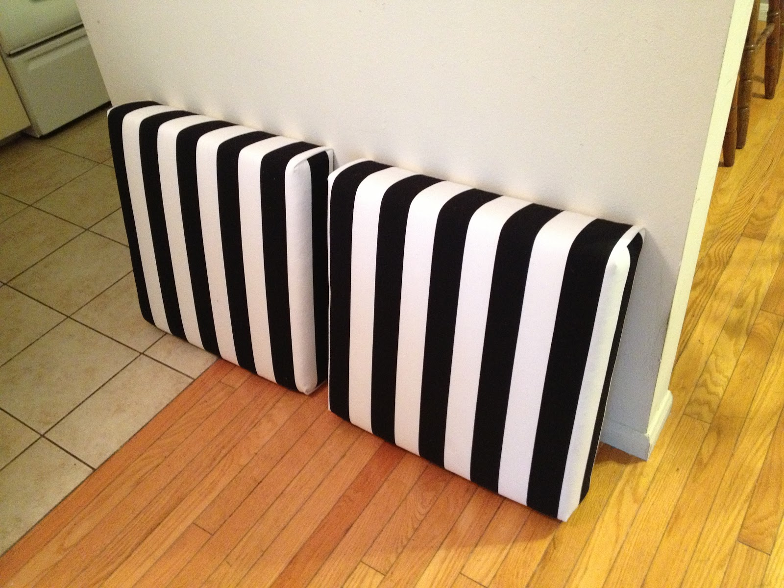 turned to design ikea lack side tables turned ottomans. Black Bedroom Furniture Sets. Home Design Ideas