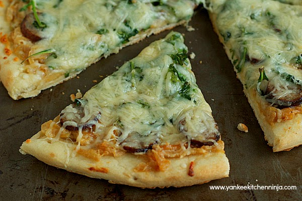 smoked sausage pizza with arugula and caramelized onion-goat cheese sauce