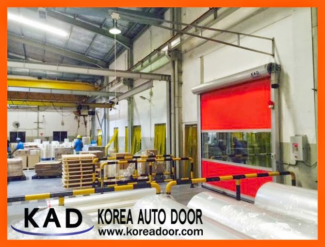 a photo shows high speed doors installed in a company which facilitate fast moving