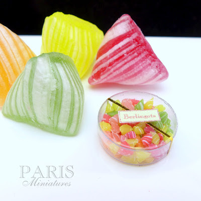 Miniature berlingots (French Candy) shown with the real thing