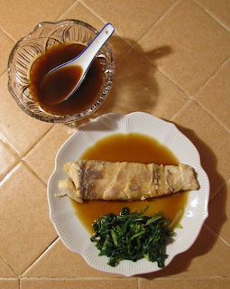 Plate of Bass, Sauce, and Side of Greens