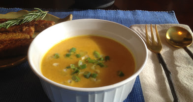 bowl of Cream of Curried Pumpkin Soup at a place setting