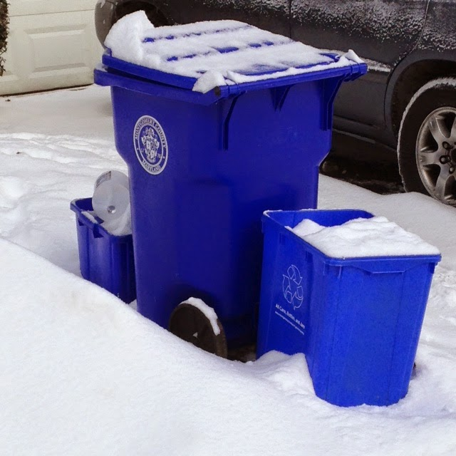 Recycling containers in snow