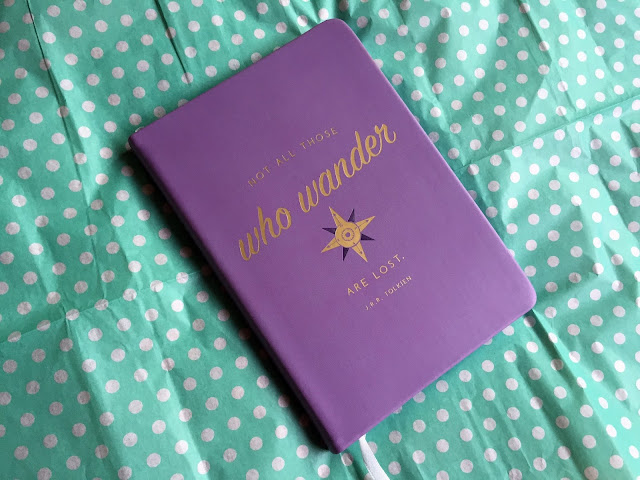 "Purple ""Not All Those Who Wander Are Lost"" Softcover Notebook"