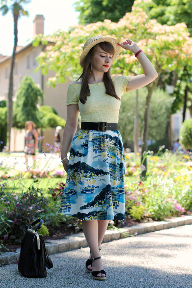 Boater hat, bardot top, novelty print skirt and frame bag