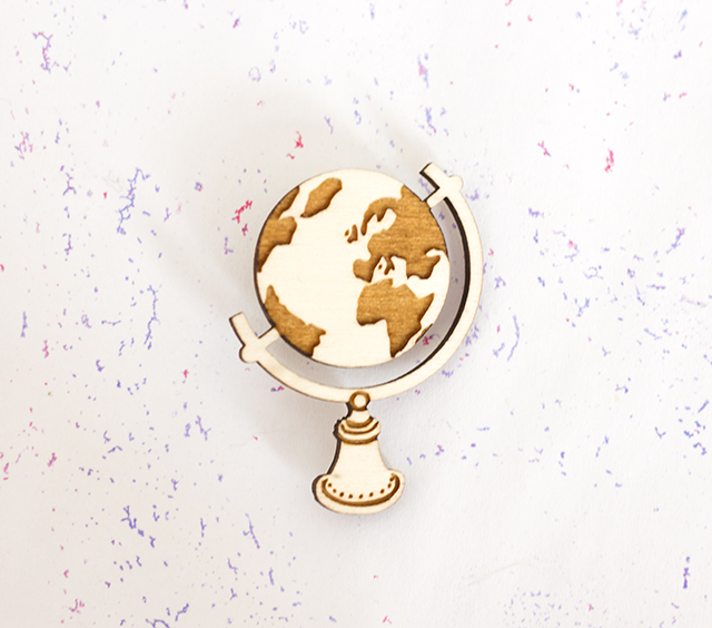 globe badge from kate rowland