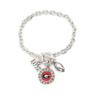 Go Bulldogs! This item is crafted from white metal with a sterling overlay. The bracelet includes a Georgia University pendant, football and a love charm. The bracelet measures 7 1/2 inches long.The total carat weight is 1/2 a carat