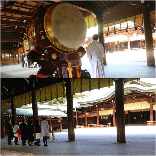 The Japanese family pray after the drum hit at one of the Shrine Memorial Hall building in Meiji Shrine, Tokyo, Japan