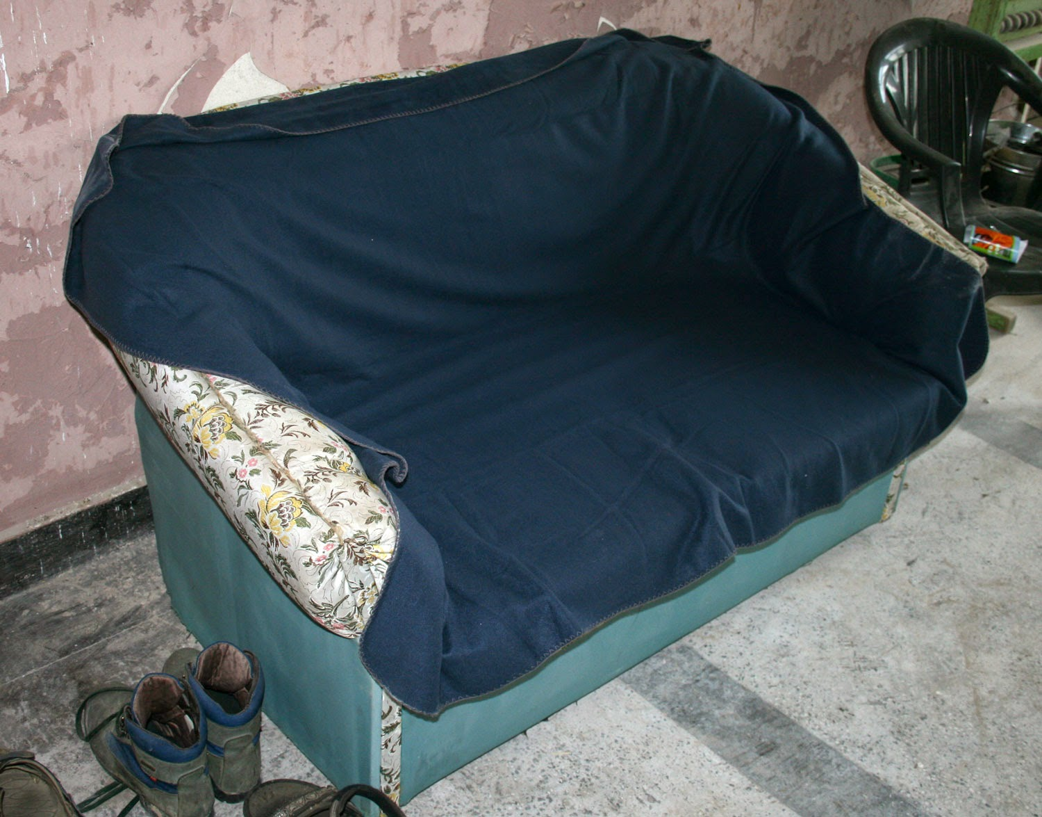 Sofa covered with a blue rug