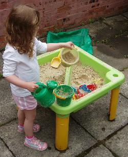 A sand-table being played with.
