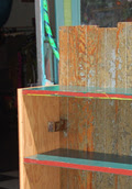 The detail of Icehouse Bookcase II shows the irregular bead-board backing and moving latch plate.