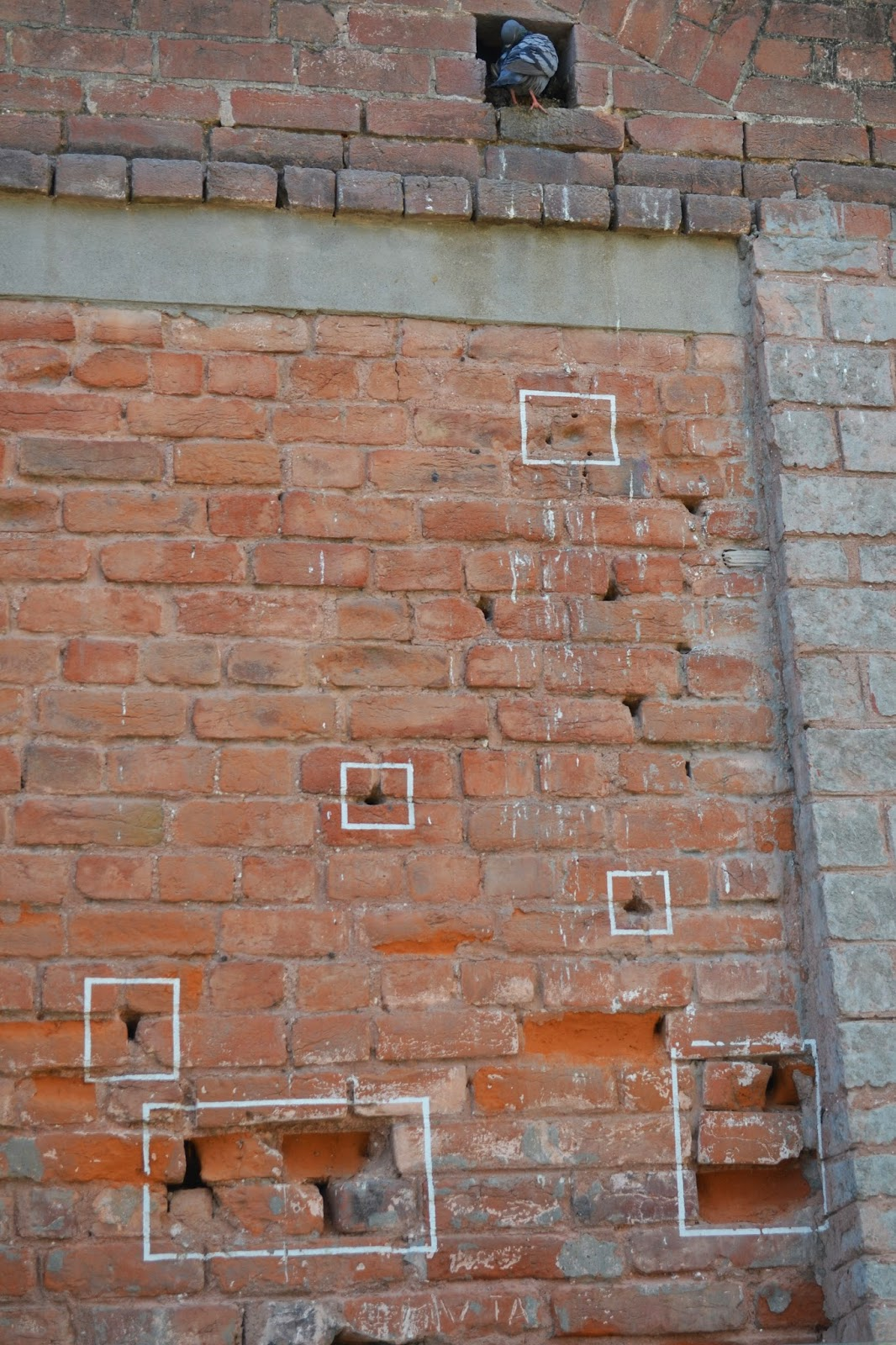 bullet marks on the wall of Jallianwala Bagh