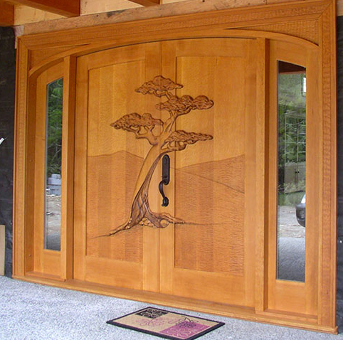 Wooden carving main doors model home interiors for Custom made wood doors