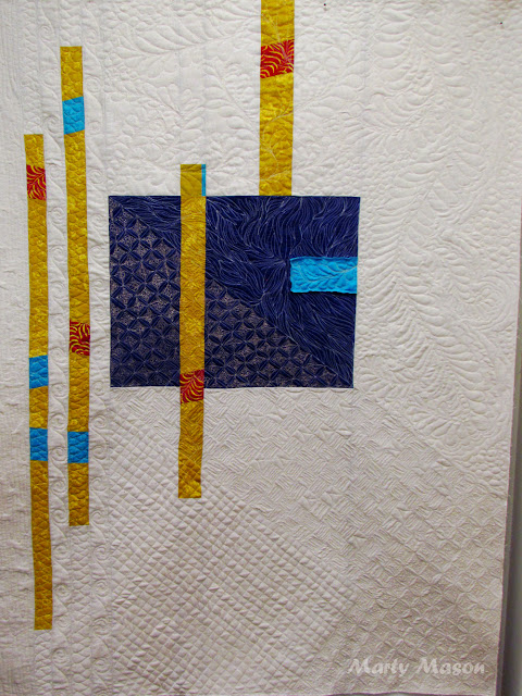 Only a few scraps remained, so I put them into a quilt:  improv style and set about random free-motion quilting