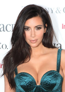 Kim Kardashian exposing sexy cleavags at ACRIA Holiday Dinner New York