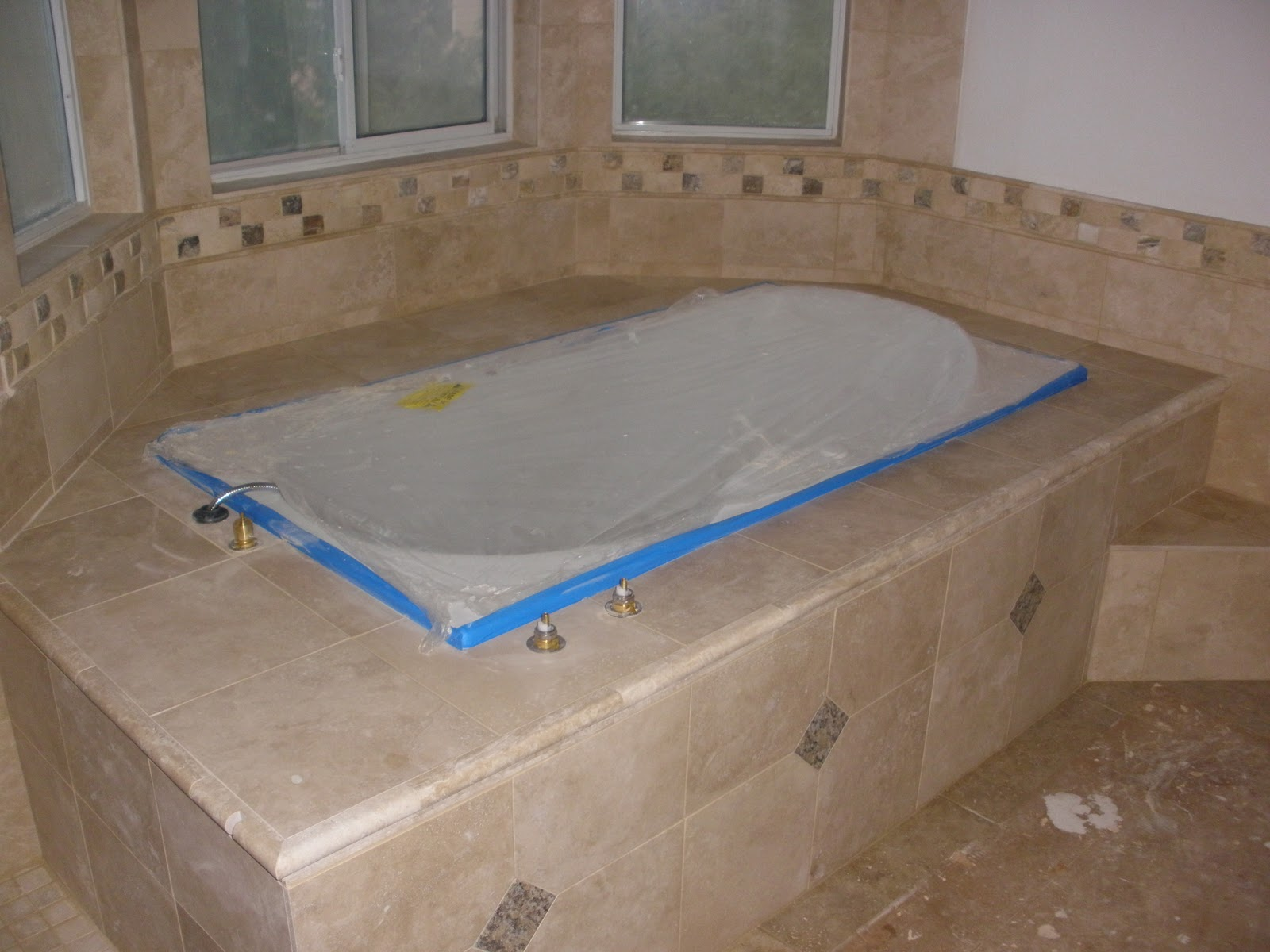 Champion floors custom tub decks and tub surrounds for Custom tubs and showers