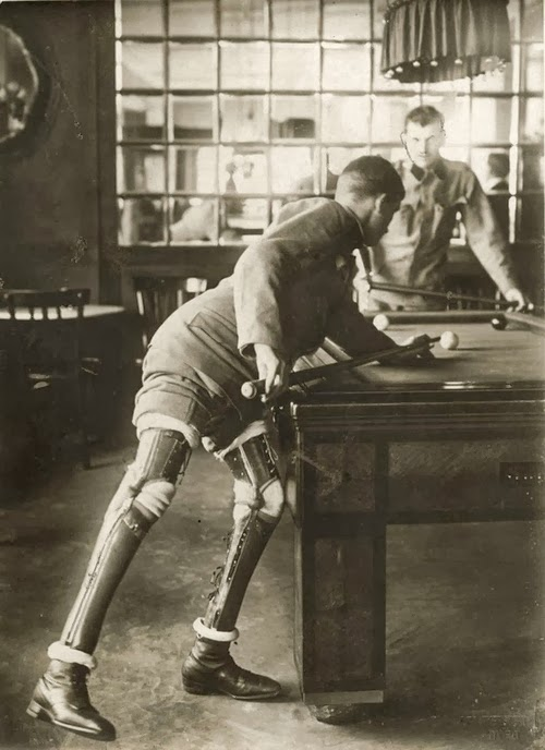 Photo of a double leg amputee world war 1 veteran playing pool