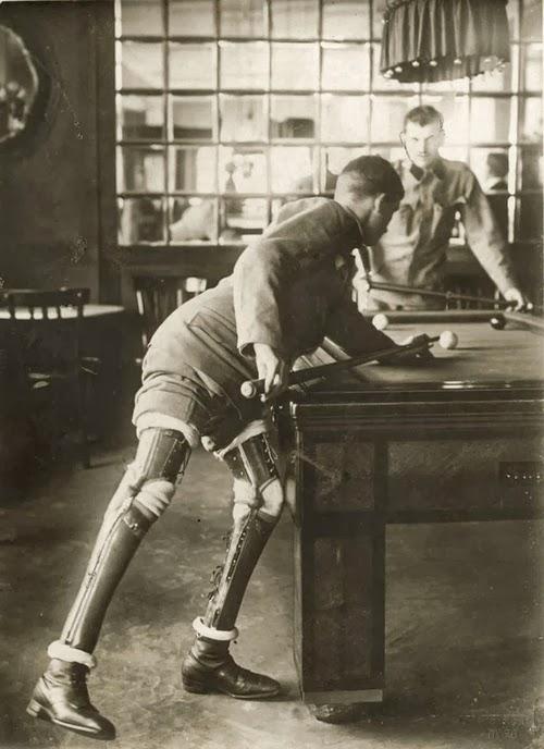 Photo of a double leg amputee world war 1 veteran playing pool