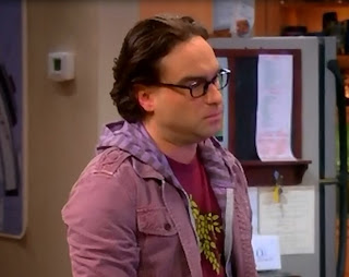 A screengrab of Leonard with his greasy-looking hair.