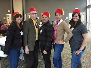 Slate Community Fellows group photo with fezzes
