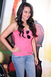 Sonakshi Sinha looking hot dabangg rowdy in pink sleeve less top standing with a aline with aviator glasses