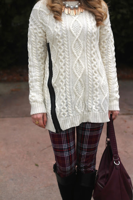 plaid pants, ivory cable knit sweater, riding boots, burgundy bag