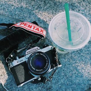 Pentax K-1000 camera with Starbucks