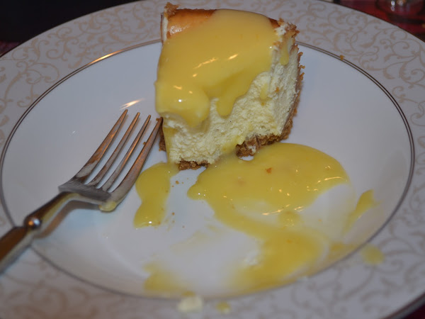 Vanilla Bean Cheesecake With a Ginger Crust and Orange Curd Sauce