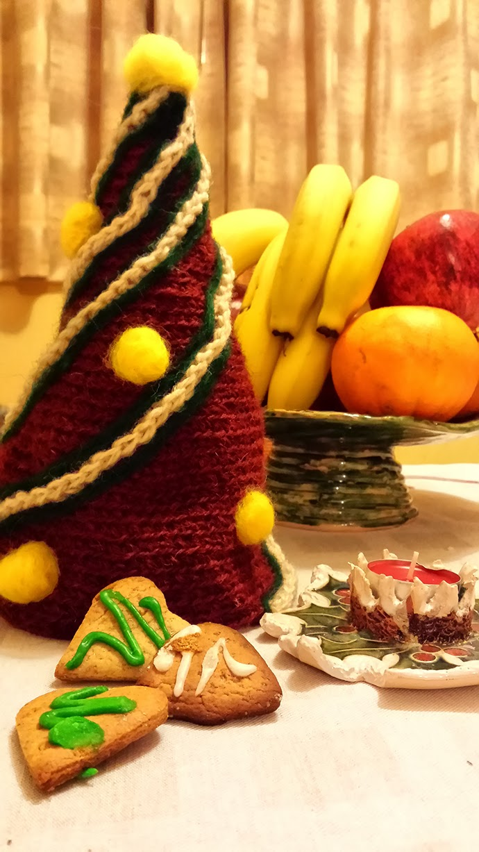 Cozy Hand-knitted Christmas Tree for decoration made of natural spun and unspun wool by knitting and hand-felting