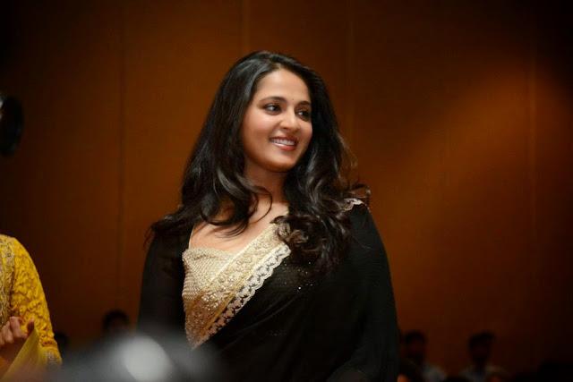 Anushka Shetty in lovely Lace Border Black Saree at Lingaa Audio Sucess Meet