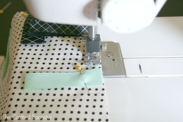 Once all ribbon tags have been pinned to the cotton print fabric
