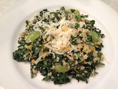 Kale salad with quinoa, grapes and manchego cheese