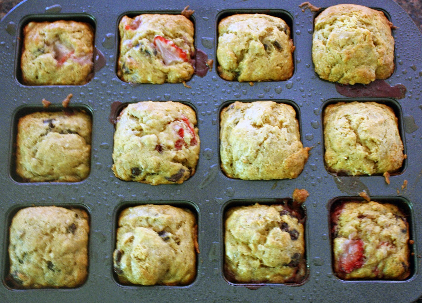 nice big and fluffy dark chocolate chunk banana strawberry muffins