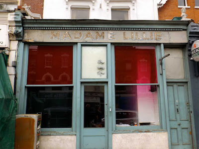 madame lille corsetiere shop ghost sign stoke newington