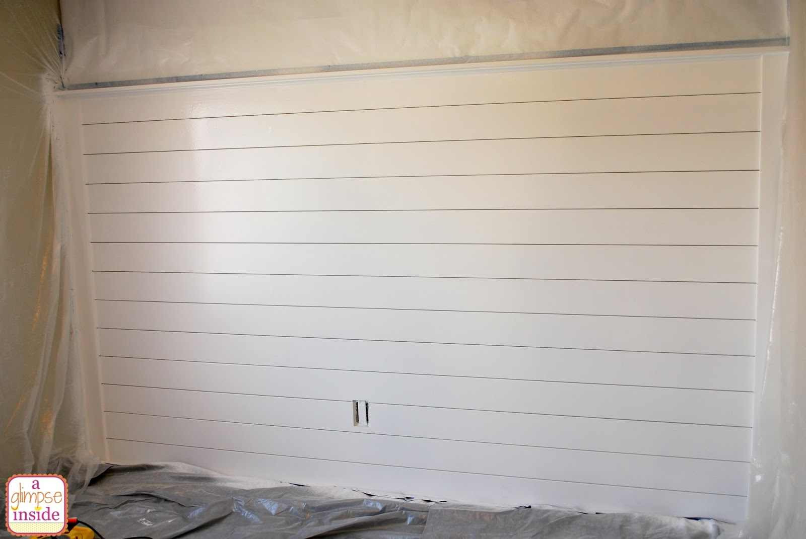 ... , paint and primer in one, in a semi-gloss finish to cover the wood