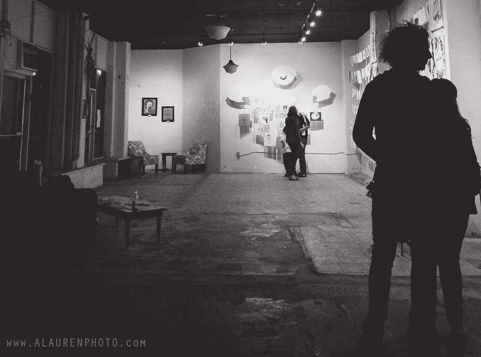 black and white photograph of couples' embraces at indy indie artist colony's monsters, myth, & mayhem exhibit