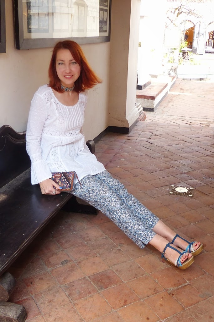 White top over baroque print cropped pants