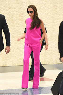 Victoria Beckham stuns in hot pink outfit at JFK airport (photos)  2C13A1A500000578-3226573-image-a-111_1441726518340