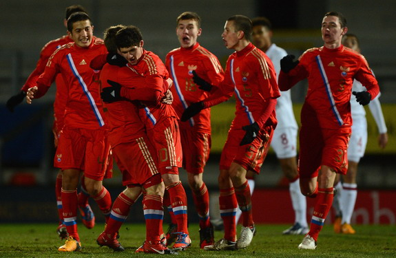 Russia U-17 player Ayaz Guliev is congratulated on scoring the equalizing goal against England U-17