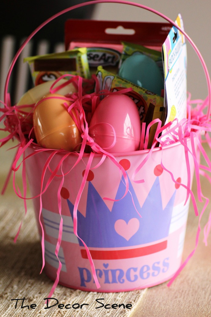 A little easter re use this pail is for our 3 month old niece so she got a couple of outfits a little toy that plays music and a cute egg just because its easter negle Images