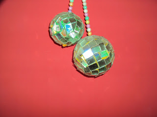 HAI THIS IS MY DISCO BALL . MADE BY WASTE CD'S.