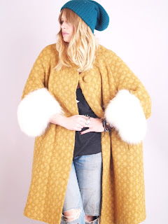Vintage 1960's mustard colored wool swing coat with white fox fur collar and cuffs.
