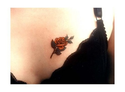 Rose tattoos on breast all about 24 for Small black rose tattoo