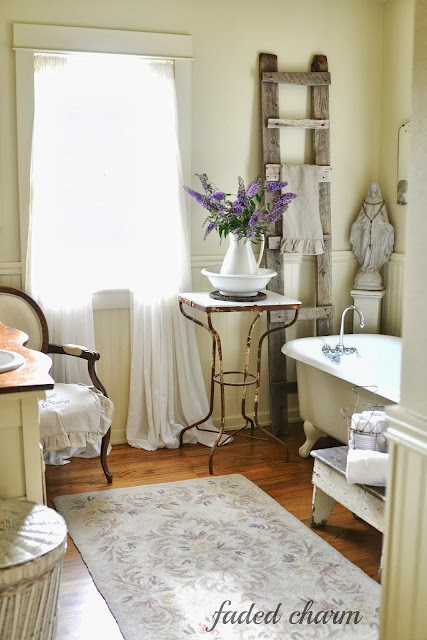 Reclaimed barnwood ladder / A beautifully reclaimed bathroom tour by Faded Charm, featured on http://www.ilovethatjunk.com